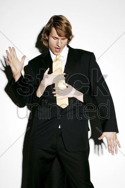 businessman being harassed stock photo