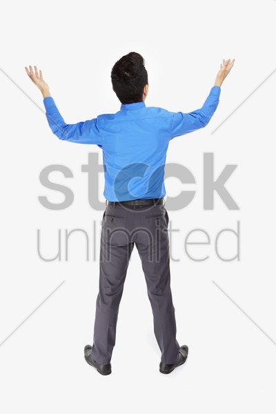 businessman lifting up his hands stock photo