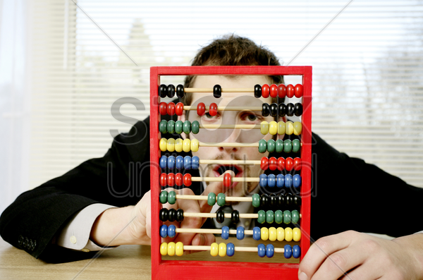 businessman playing with children abacus stock photo