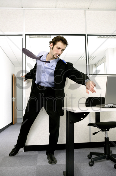 businessman running in to save his computer stock photo