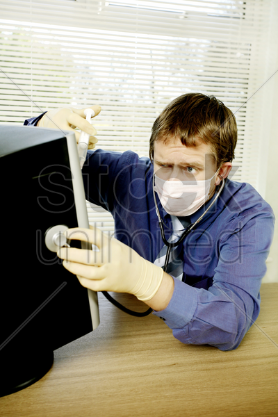 businessman saving his computer from virus stock photo