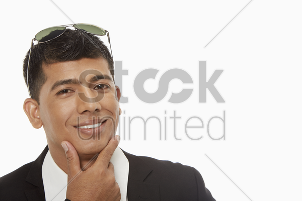 businessman smiling and showing hand gesture stock photo