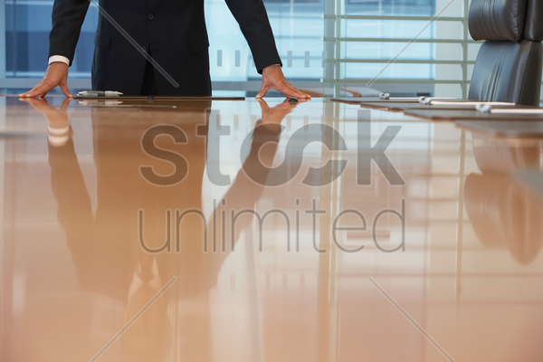 businessman standing at conference table stock photo