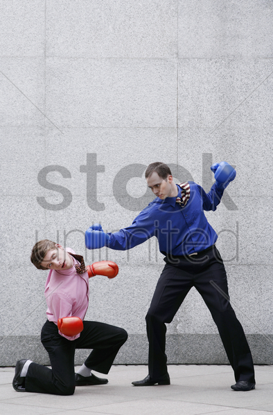 businessmen in boxing gloves fighting stock photo