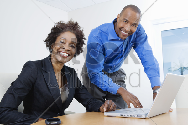 businesspeople using laptop stock photo