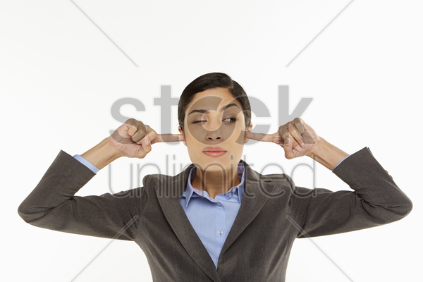 businesswoman covering her ears stock photo