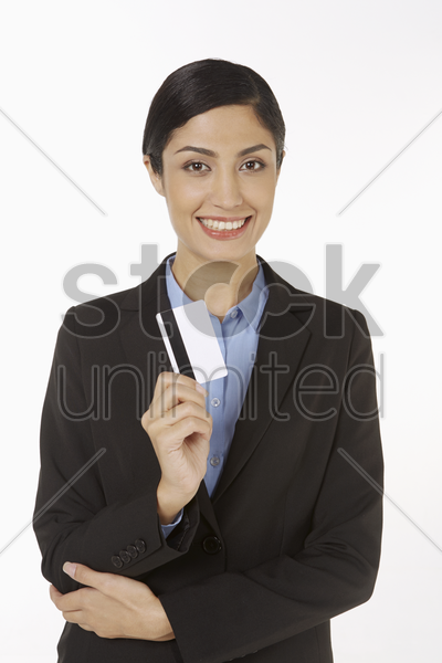 businesswoman holding a credit card stock photo
