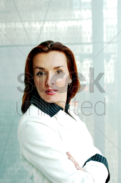 businesswoman looking at the camera stock photo