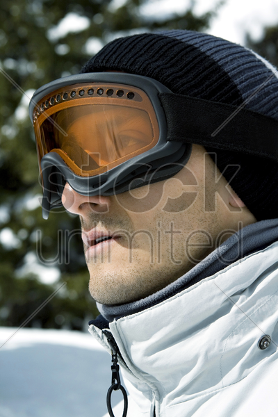 close up of a man wearing ski goggles stock photo