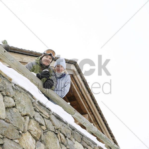 couple in warm clothing stock photo