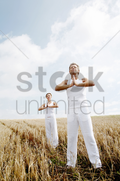 couple practicing yoga stock photo