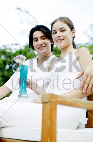 couple smiling at the camera stock photo