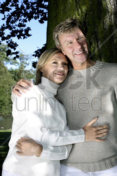 couple smiling while hugging stock photo
