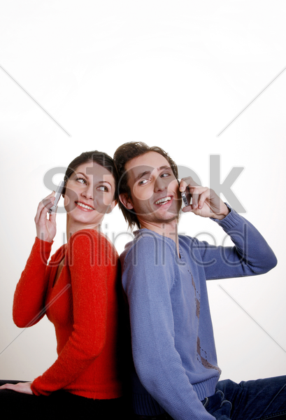 couple talking on the phone stock photo