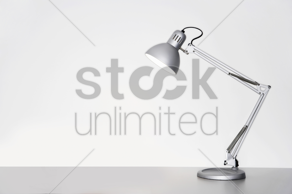 desk lamp on table over white background stock photo