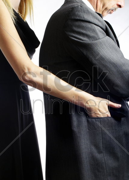 female pickpocket stealing from a businessman stock photo