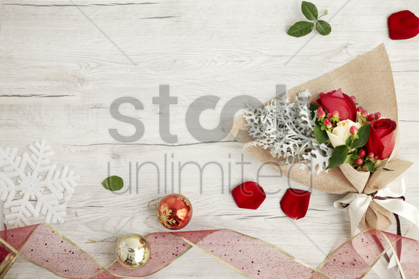 flat of wooden background with roses stock photo