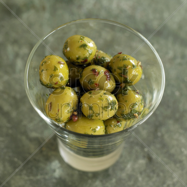 glass of fresh italian olives stock photo