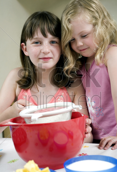 kids learning baking stock photo