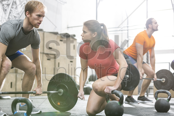 people weightlifting in crossfit gym stock photo