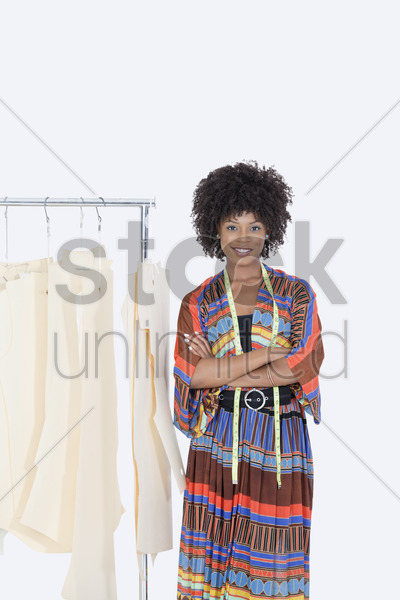 Portrait of an african american female designer with sewing patterns ...