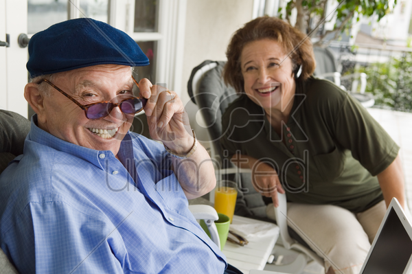 senior couple relaxing on porch stock photo