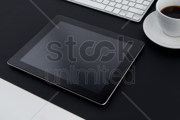 tablet with coffee mug and keyboard stock photo