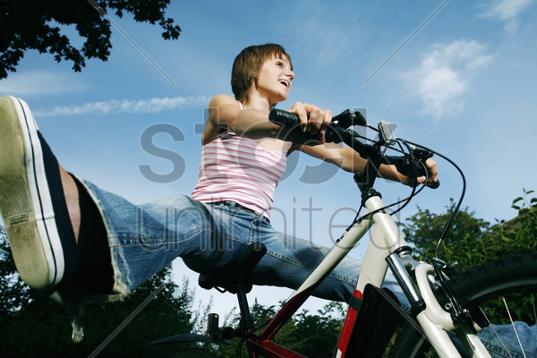 Teenage Girl Spreading Her Legs While Sitting On Bicycle Stock Photo - 1685230 -8122