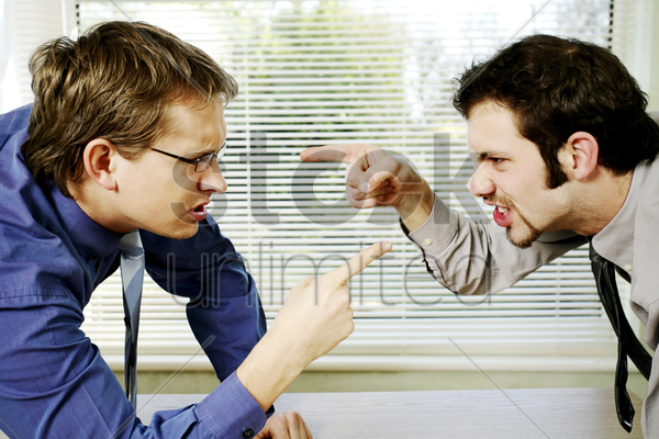 two businessmen arguing stock photo