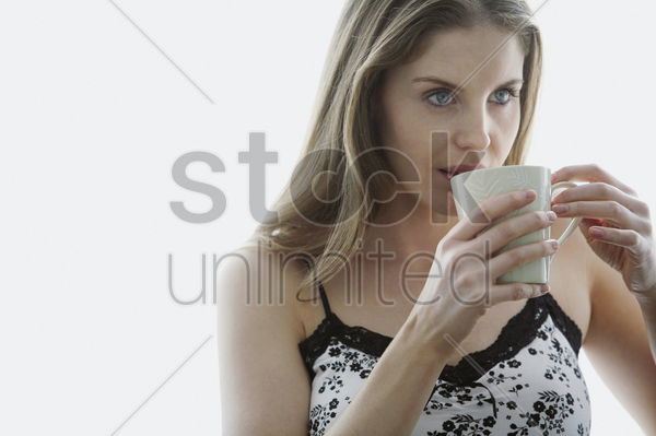 woman enjoying a cup of coffee stock photo