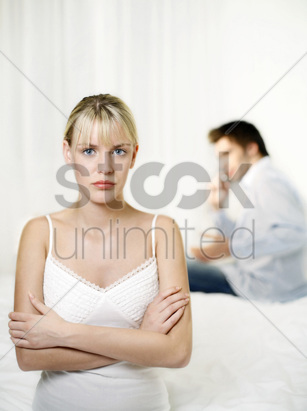 woman getting frustrated with her boyfriend for ignoring her stock photo