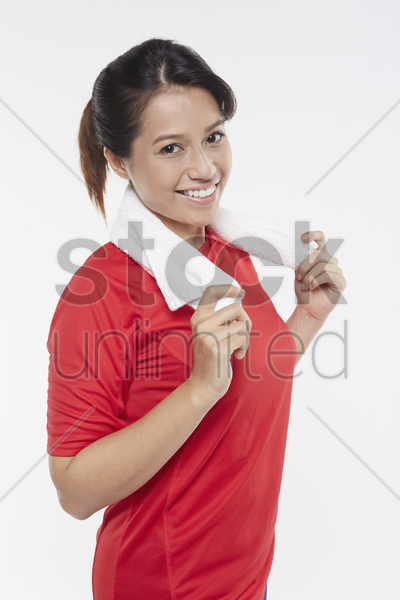 woman holding a face towel stock photo