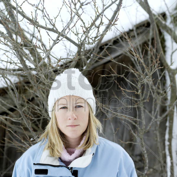 woman in warm clothing and white knitted hat stock photo