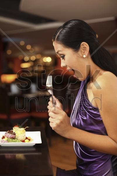 woman looking happily at her food stock photo