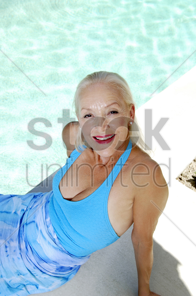 woman posing by the pool side stock photo