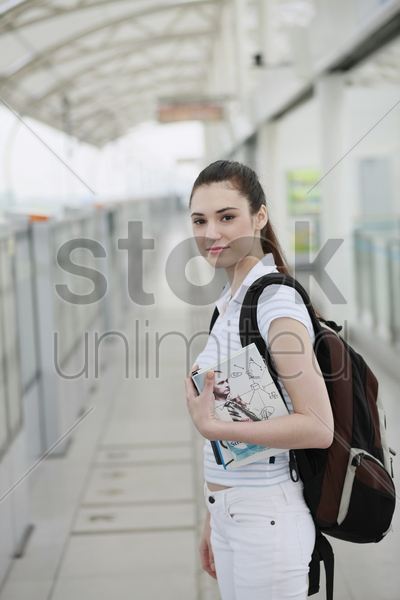 woman waiting for train to arrive stock photo