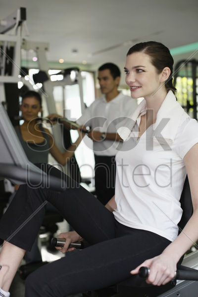 women exercising in the gymnasium stock photo