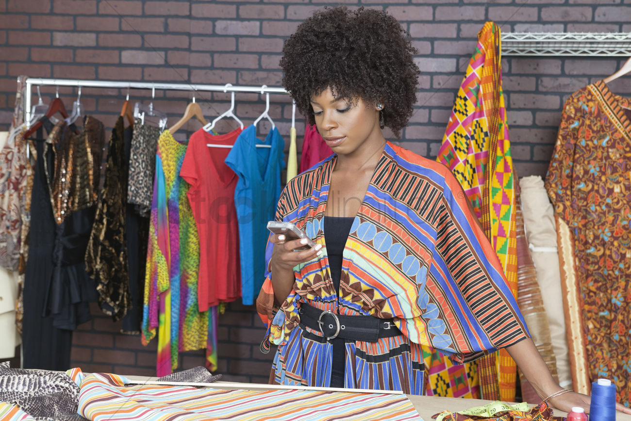 Attractive african american female fashion designer using ...