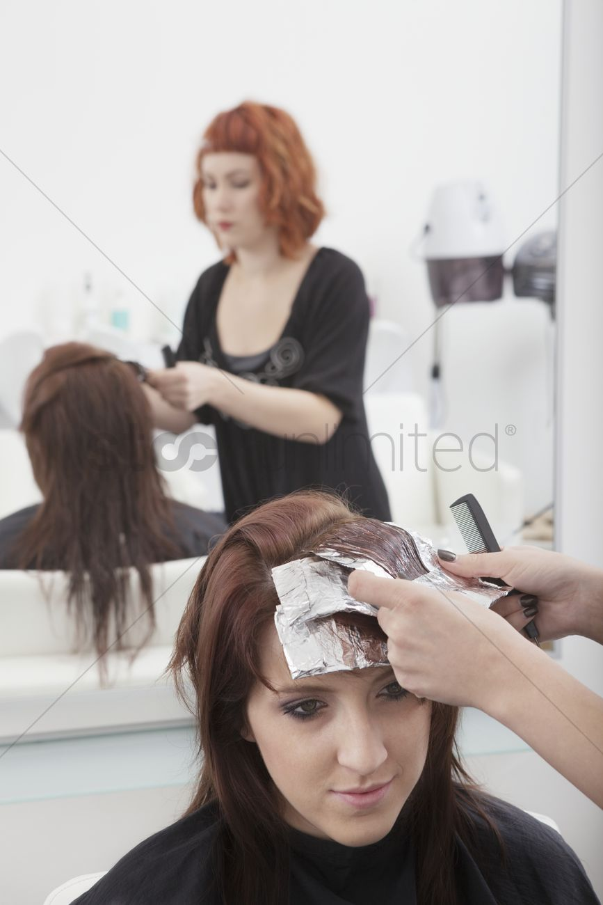 Colourist places foils in hair Stock Photo - 1915562 | StockUnlimited