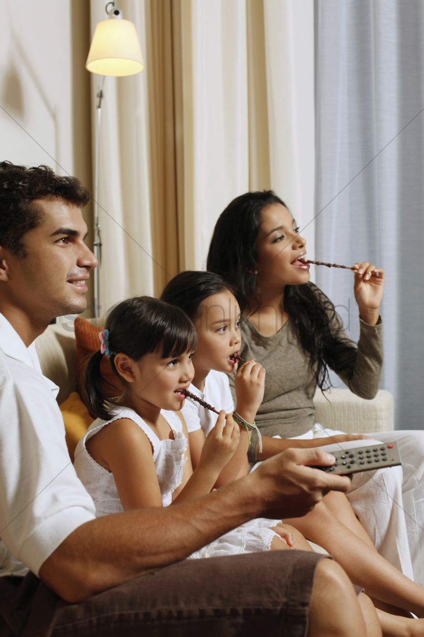 family watching tv together stock photo 1864742