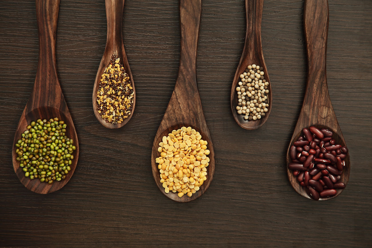Flat Lay Of Beans And Spices On Wooden Spoons Stock Photo 2110510