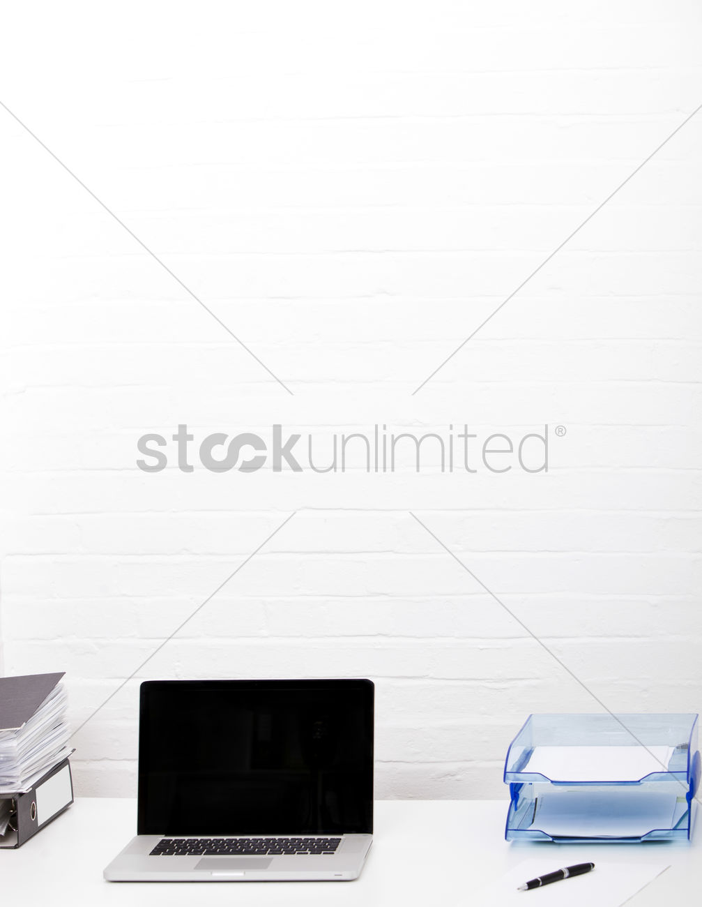 Laptop And Paper Tray On Office Desk Stock Photo