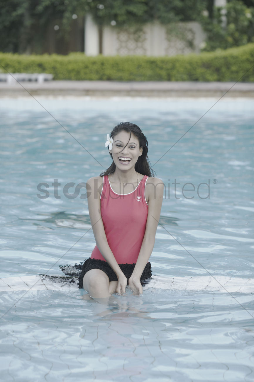 Portrait of a young woman sitting in a swimming pool stock photo 2091494 stockunlimited for Female only swimming pool london