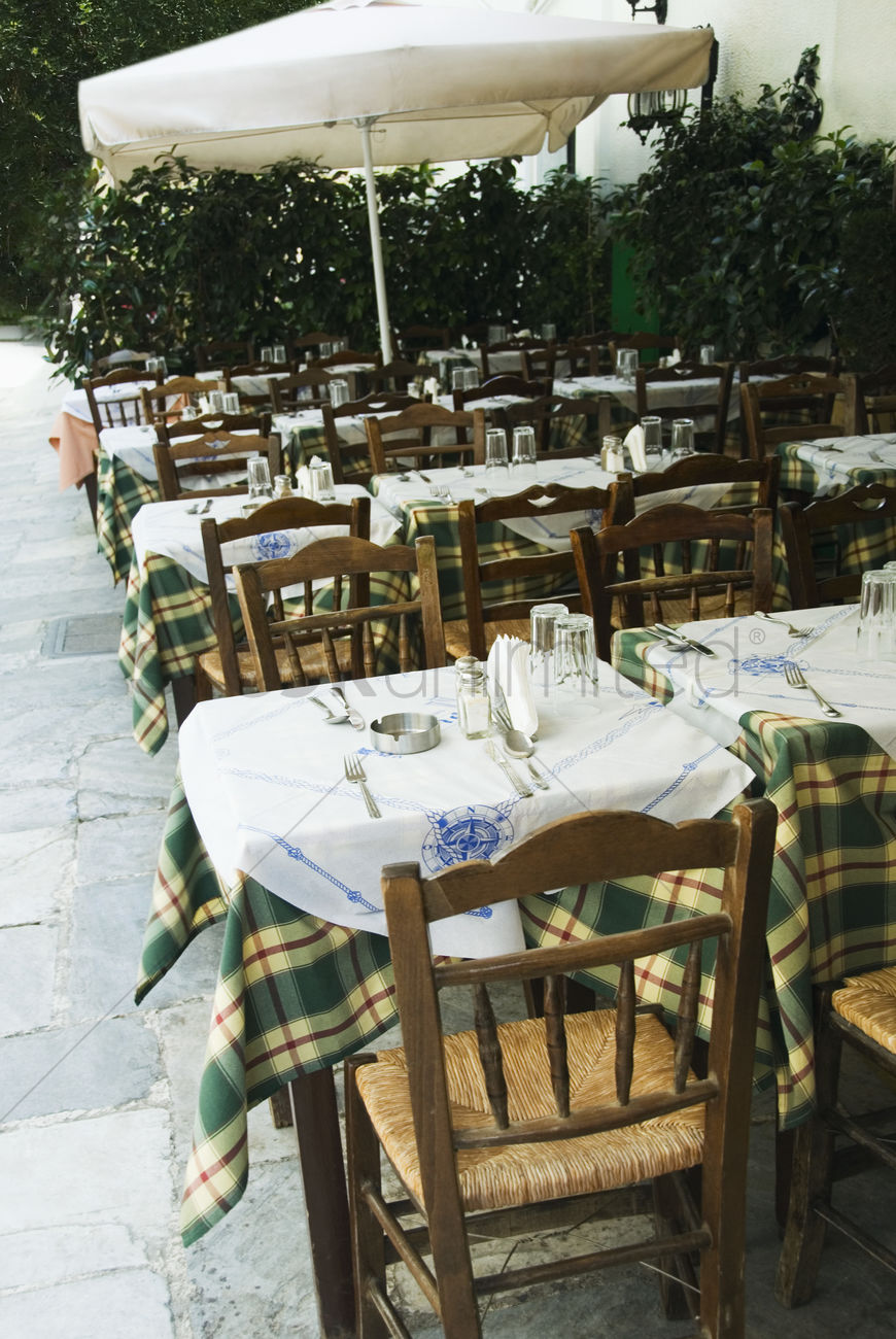 Tables and chairs at a sidewalk cafe athens greece stock photo