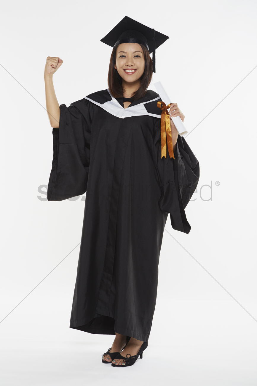 Woman in graduation gown cheering Stock Photo - 1855786   StockUnlimited