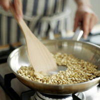 Popular : A chef using a spatula to fry nuts