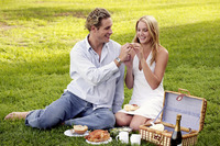 A couple picnicking on the field