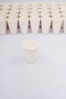 A group of paper cups with an isolated paper cup