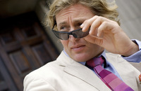 Popular : A man in business suit adjusting his sunglass