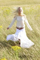 A woman running happily on the prairie